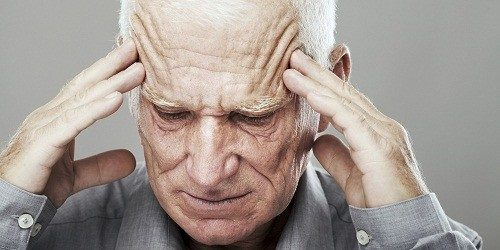 senior man with headache
